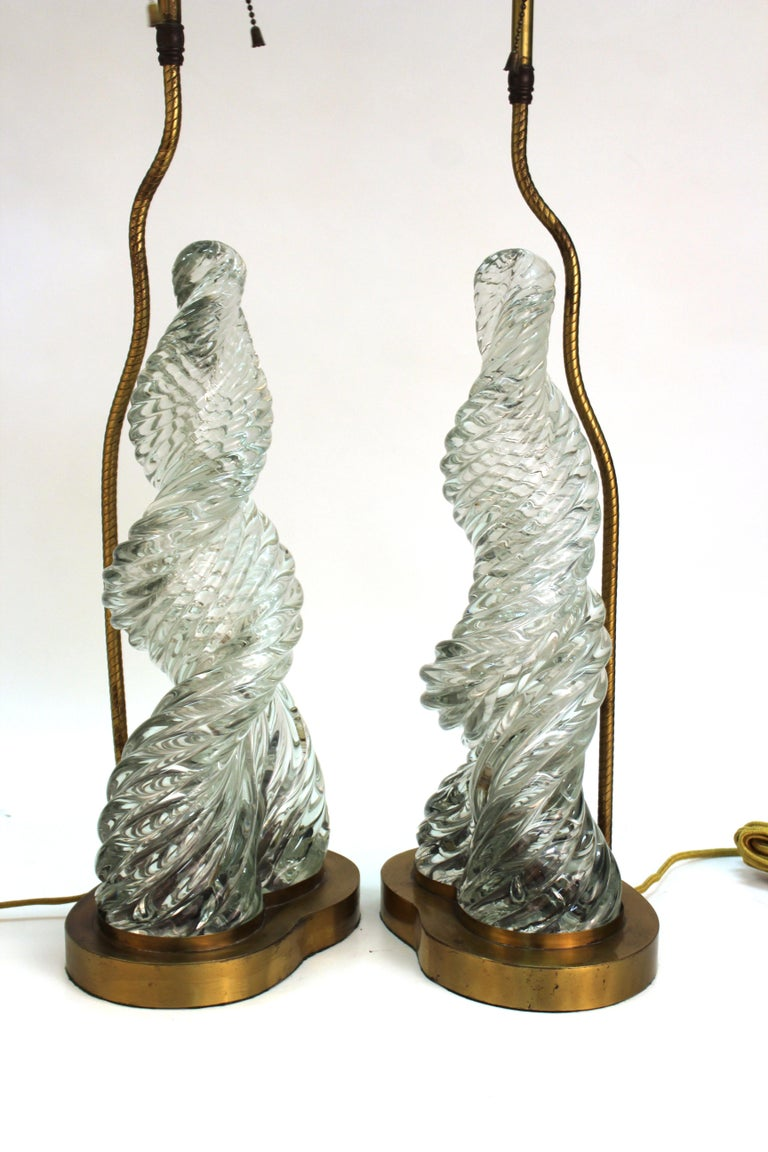 Italian Murano glass 'Diamante' pair of table lamps created by Paolo Venini and Carlo Scarpa. The pair has tall twisted swirl glass elements rising atop metal bases with brass hardware in the back holding up the light sources. The pair is in good
