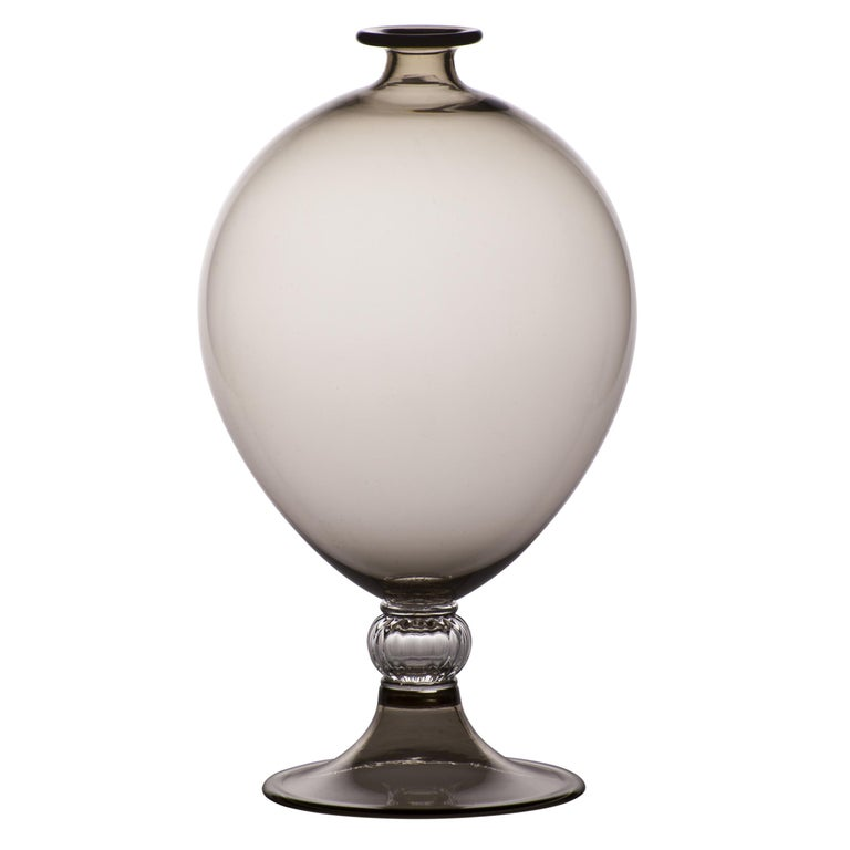 Venini glass vase with cylindrical body and crystal decorative base. Featured in grey colored class with crystal designed in 1921. Perfect for indoor home decor as container or strong statement piece for any room.  Dimensions: 20 cm diameter x 32
