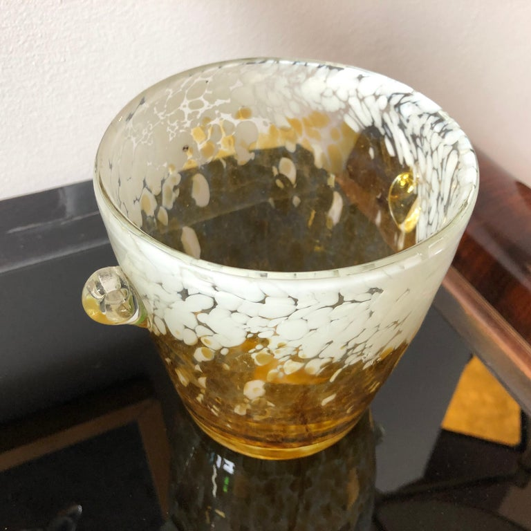 It's a Venini ice bucket made for the famous company Di Saronno producer of the Amaretto di Saronno. Yellow and white Murano glass is in perfect conditions.
