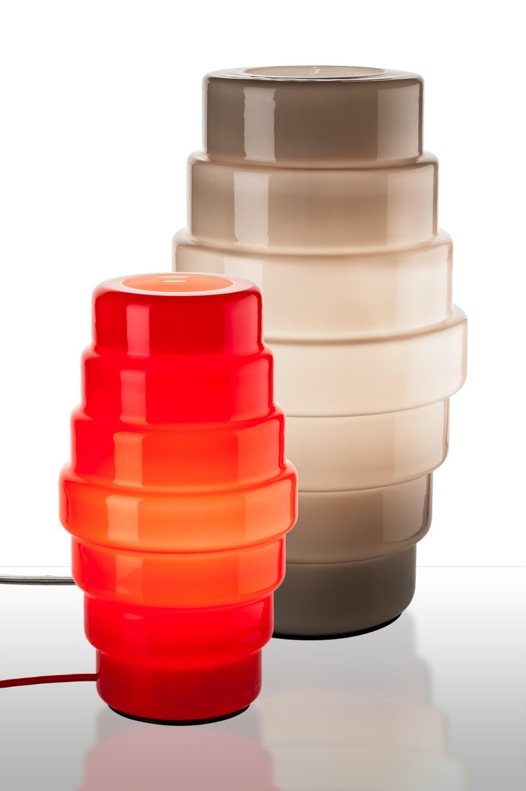 Zoe Tavolo table lamp, designed by Doriana and Massimiliano Fuksas and manufactured by Venini, features a lantern shape.  Indoor use only.  Dimensions: Ø 20 cm, H 53 cm
