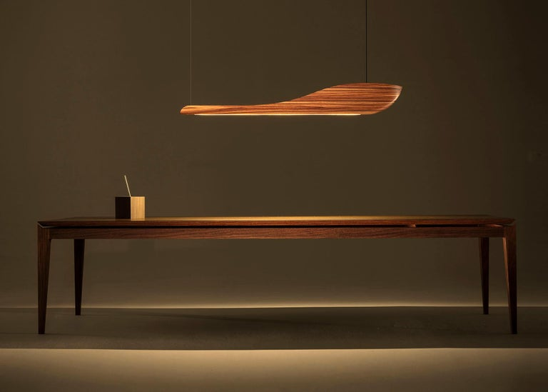 Limited edition and imposing, the Vento pendant light is the new piece by Marcos Amato. Handmade by the artist himself, with the most noble hardwoods, its drawing emerged from the love for the sea and water. It's volume causes presence and it's