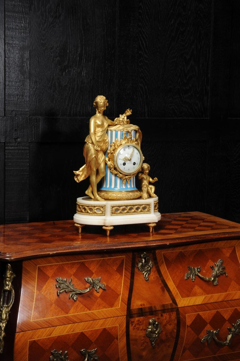 A stunning ormolu and Sèvres style porcelain clock, after the original clock in Marie-Antoinette's apartment in the Palace of Versailles. It dates from circa 1870. Venus is beautifully depicted leaning on a classical column with two doves, two