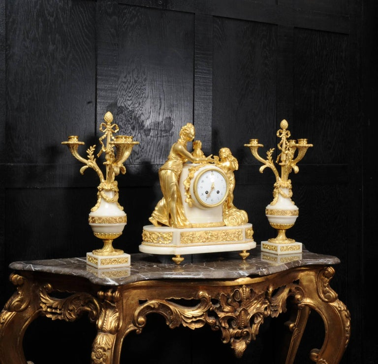 French Venus with Amour and Dog, Superb Ormolu and White Mable Clock Set, circa 1900 For Sale