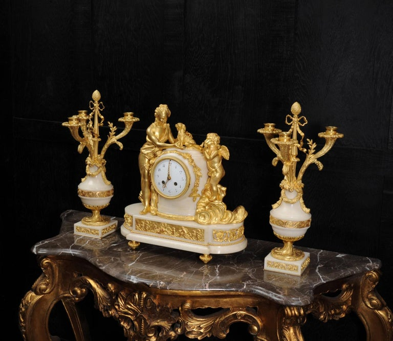 Carved Venus with Amour and Dog, Superb Ormolu and White Mable Clock Set, circa 1900 For Sale