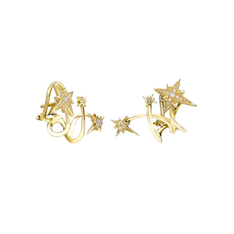 Lady Australis and Lady Borealis kiss Planet Venyx from above as they dance across the heavens and swathe celestial spaces in their colourful light. Such is the beauty of the Auroras, depicted in these starrily studded ear cuffs.  18kt Yellow Gold