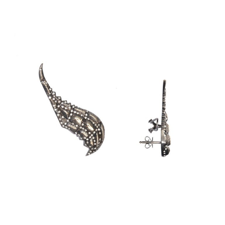9kt White Gold approx 16.75gr, Black Rhodium and 182 Diamonds 1.32ct  Meet the Black Lady Caiman.  Wear the precious skin of this prehistoric predator. A protective layer that divides the visible from the invisible.  Strong and fearless, protagonist