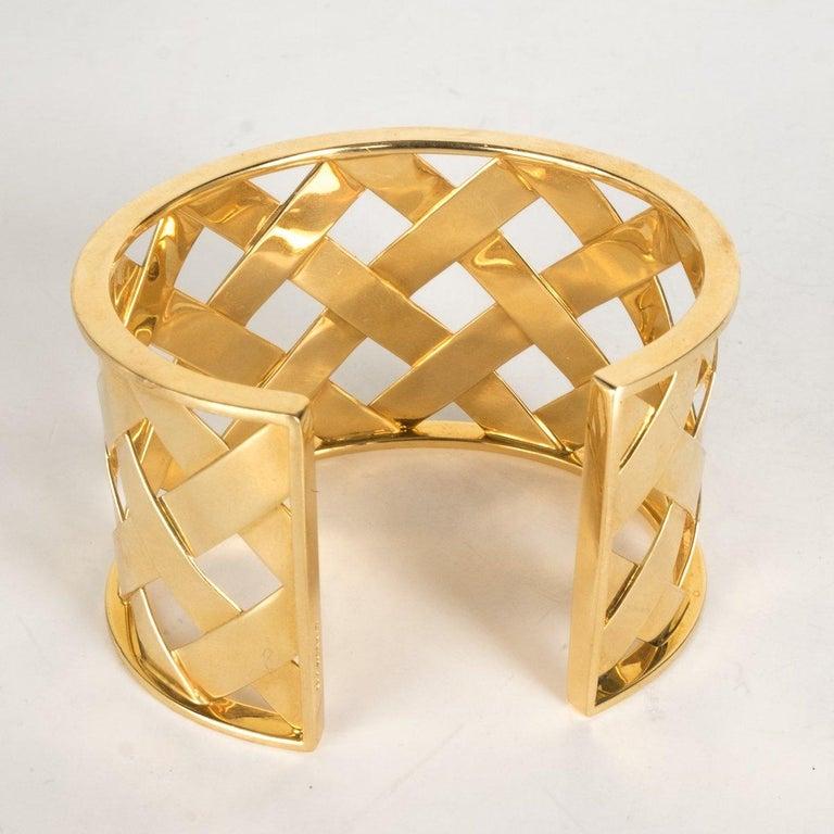 Verdura 18K yellow gold Criss Cross cuff.   Metal Type: 18K Yellow Gold Hallmark: 750, Designer Signature Signature: Verdura Location: End Cap Metal Finish: High Polish Total Item Weight (g): 64.0   This item has previously been worn. Minor