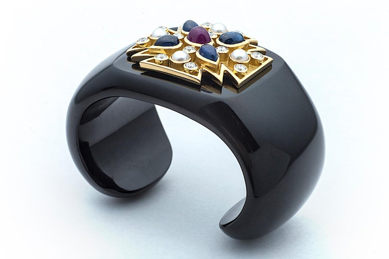 The Maltese cross symbolizes protection and a badge of honor and you will possess both when wearing this iconic Verdura statement cuff.  Designed of shiny rich black carved jade, this fashionable cuff showcases an 18K yellow gold Maltese cross set