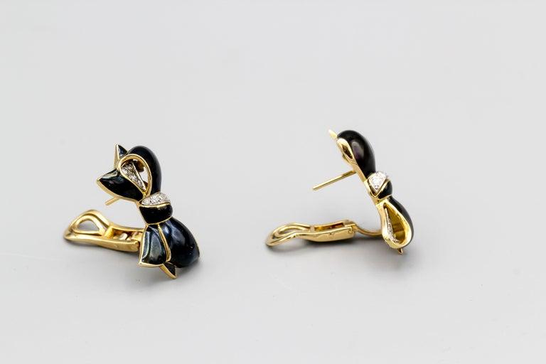 Fine diamond, black enamel and 18K yellow gold