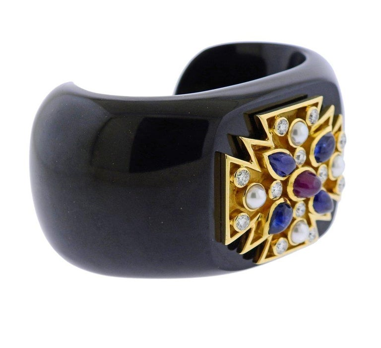 Iconic Maltese Cross bracelet by Verdura, decorated with black jade, approx. 1.80ctw in G/VS diamonds, pearls, sapphires and rubies. Bracelet is set with following gemstones:  Jade, Diamonds - 1.80ctw, Pearl, Sapphire, Ruby.  Bracelet will fit