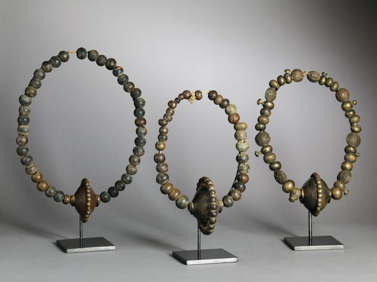 Cast brass necklace or waist beads. Very little is known about this small Ethnic Group, numbering about 20.000 people in Eastern Nigeria close to the Cameroon border. There's no similarity to be found with the neighbouring Tribes, the Bata and the
