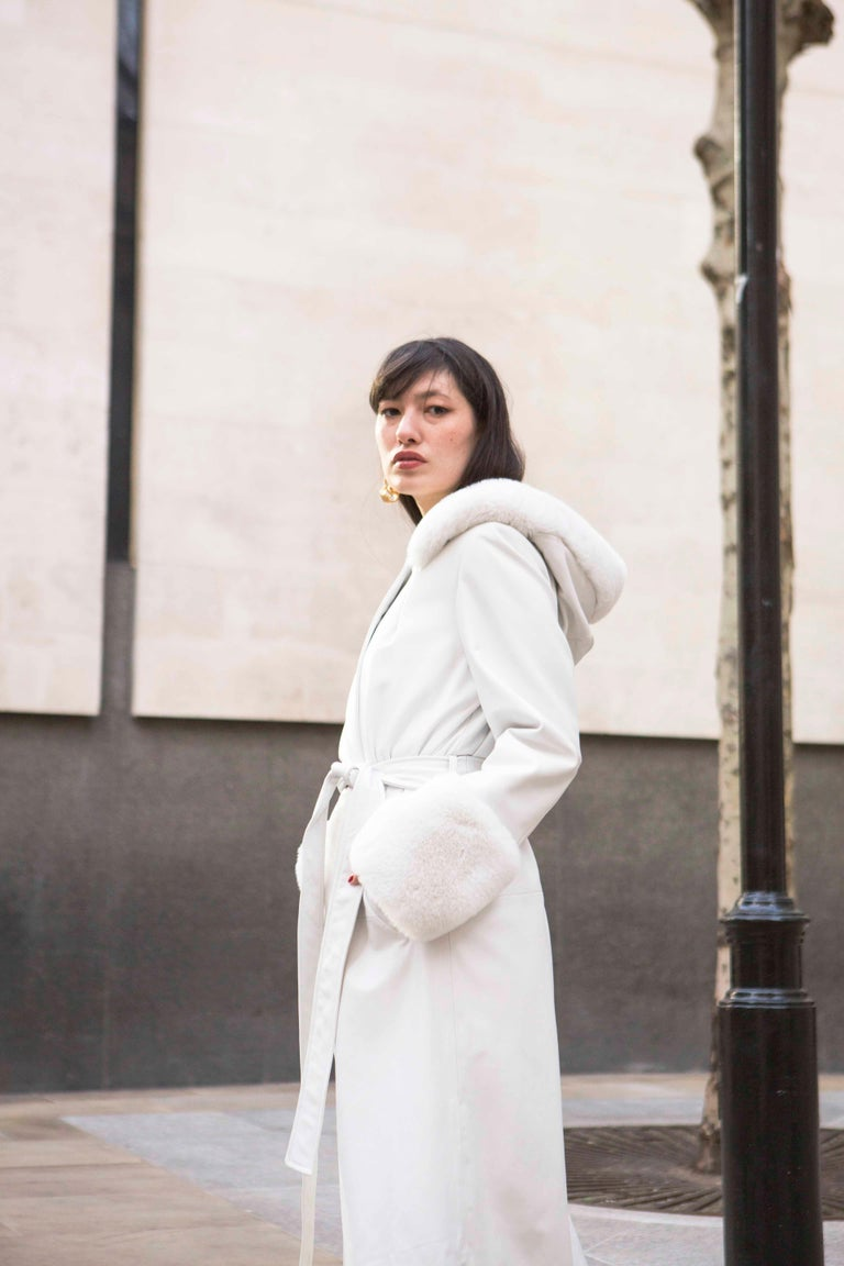 Verheyen London Hooded Leather Trench Coat in White with Faux Fur - Size uk 10  Handmade in London, made with 100% Italian Lambs Leather and the highest quality of faux fur to match, this luxury item is an investment piece to wear for a lifetime.