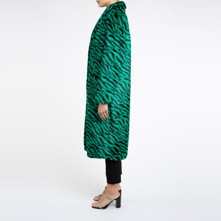 Esmeralda Faux Fur Coat in Emerald Green Zebra Print size uk 10   A coat for dressing up and down with jeans or a dress and to keep you cosy for the cold weather.  This longline design is flattering and easy to wear with jumpers etc with its relaxed