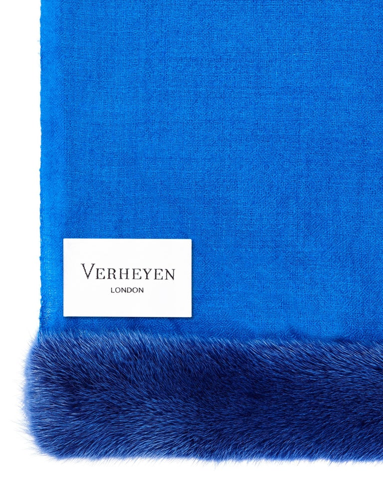 Verheyen London Handwoven Mink Fur Trimmed Cashmere Shawl in Blue - Brand New   Verheyen London's shawl is spun from the finest lightweight handwoven cashmere from Kashmir and finished with the most exquisite dyed mink. Its warmth envelopes you with