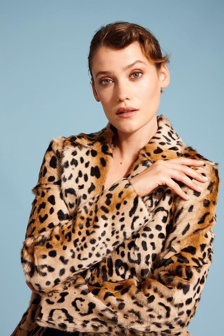 This Leopard print coat is Verheyen London's classic staple for effortless style and glamour. A coat for dressing up and down with jeans or a dress.  PRODUCT DETAILS  High Collar Leopard Print Coat  Size: UK 12 Colour: Natural  Dyed Printed Goat