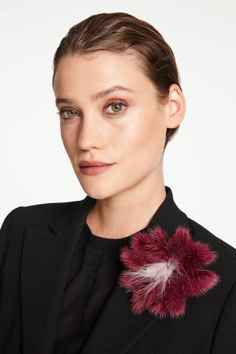 The perfect valentines gift, this Verheyen London mink fur flower brooch is designed to add a glimmer of warmth and fun to your look.  Wear on your favourite winter knit or over a cape for glamour.  PRODUCT DETAILS  Colour: Berry Burgundy Material: