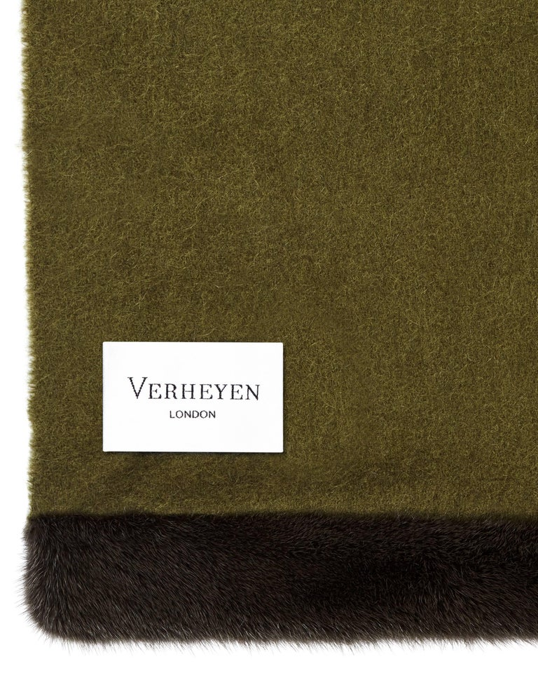 Verheyen London's shawl is spun from the finest Scottish woven cashmere and finished with the most exquisite dyed mink. Its warmth envelopes you with luxury, perfect for travel and comfort wherever you are.  PRODUCT DETAILS Verheyen London Cashmere