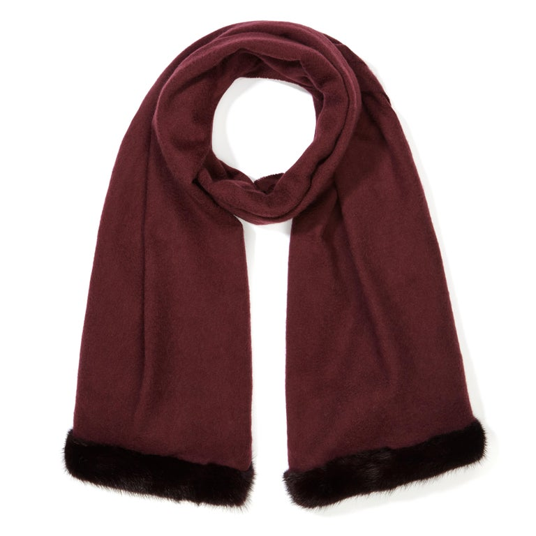 Verheyen London Mink Fur Trimmed Cashmere Shawl Scarf in Rich Burgundy Gift   Verheyen London's shawl is spun from the finest Scottish woven cashmere and finished with the most exquisite dyed mink. Its warmth envelopes you with luxury, perfect for