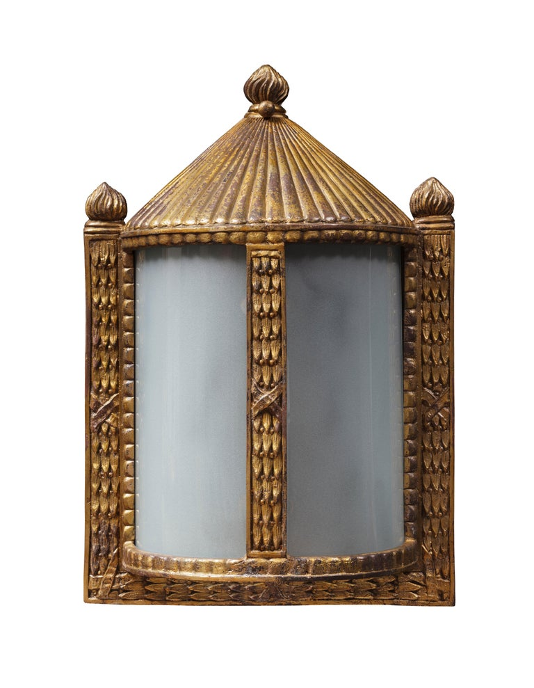 Drawing on the decorative style of late the 18th century, this wall lantern of semi cylindrical form is framed with molded bronze fasces, a tent-like top and three stylized flames.  Available in antique Verdigris finish.