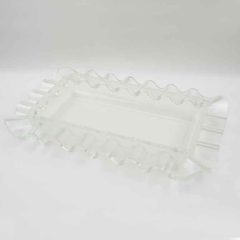 Impressive sculptural Art Deco frosted centerpiece bowl by Verlys, France. A large-scale frosted and clear glass bowl with geometric waved design, produced by Les Verreries d'Art Verlys & des Hanots - S.A. Holophane, Paris. Molded signature of