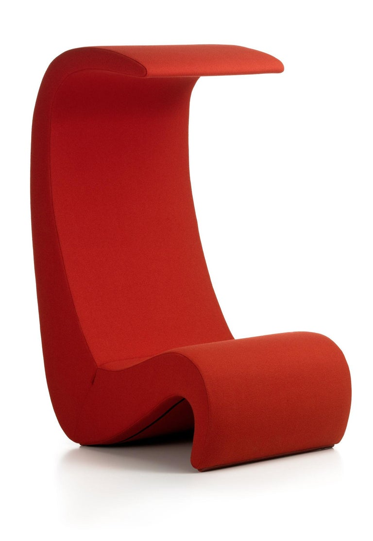 Chair designed by Verner Panton in 1970. Manufactured by Vitra, Switzerland.  With its curving shapes and vivid colours, the Amoebe chair (1970) by Verner Panton embodies the exuberant spirit of the early 1970s. Thanks to its upholstered surfaces