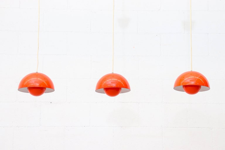 Midcentury Verner Panton flower pot pendant light for Louis Poulsen in 1969, Denmark with Dual orange enameled shades. Designed in the 1960s the shades are connected by metal hooks to complete its futuristic style. In original condition with minimal