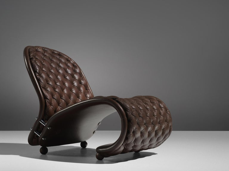 Verner Panton for Fritz Hansen, lounge chair model G, brown leather, Denmark, 1973  Iconic lounge chair by Vener Panton in 1973. The 'G' lounge chair shows the dynamic that Panton's designs are famous for. Two curved parts are held together by