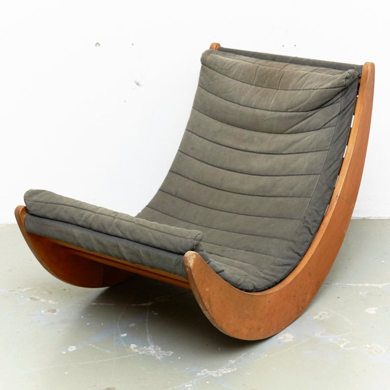 Relaxer chair designed by Verner Panton circa 1970, manufactured for Rosenthal in Denmark.  In original condition, with minor wear consistent with age and use, preserving a beautiful patina. The wood has some scratches and the upholstery has some