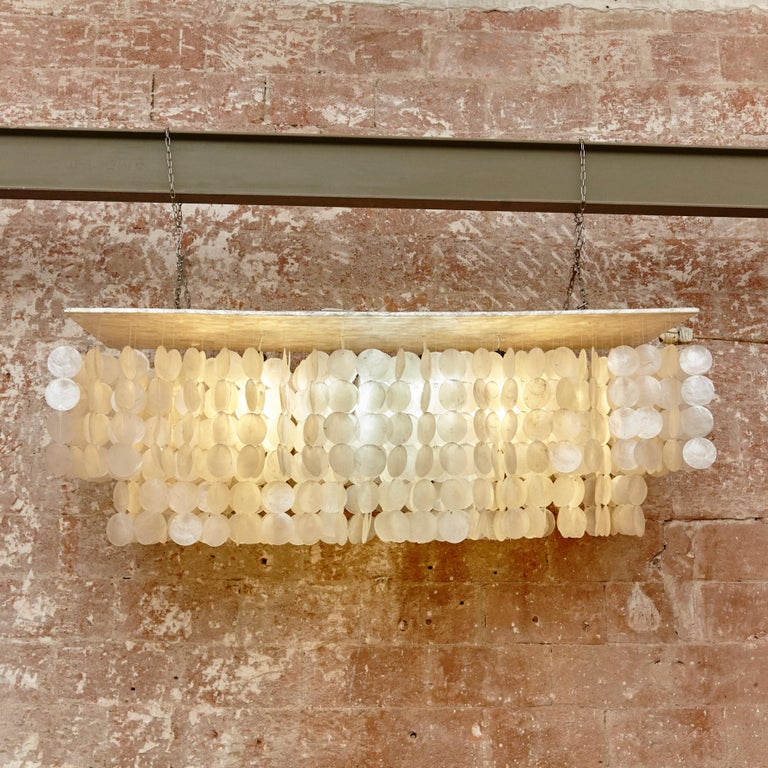Chandelier lamp made by Capiz Shell manufactured in 1970  Measures: H 45 x W 120 x D 40.