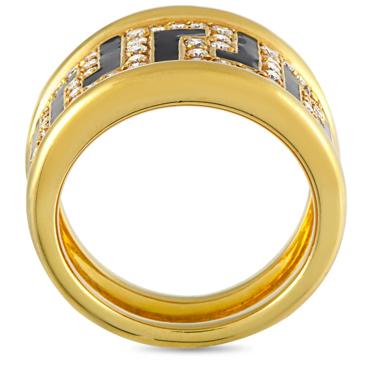 This Versace ring is made out of 18K yellow gold and enamel and set with a total of 0.75 carats of diamonds. The ring weighs 13.7 grams, boasting band thickness of 10 mm and top height of 4 mm, while top dimensions measure 13 by 21 mm. This item