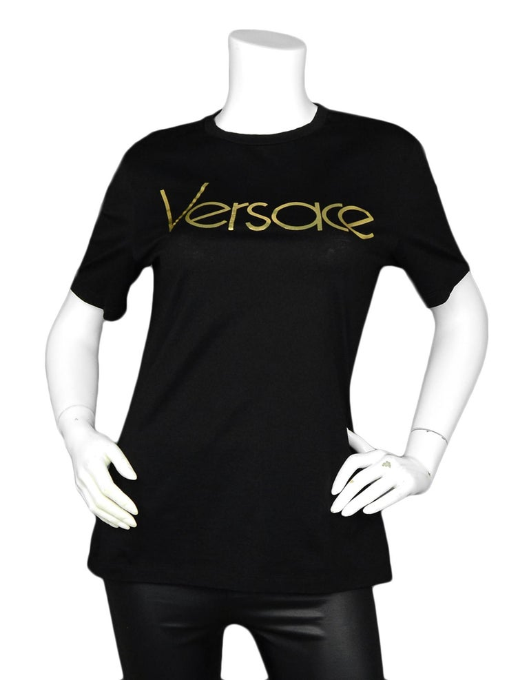 Versace Black/Gold Vintage Logo T-Shirt sz 40IT 4US  Made In: Italy Color: Black Gold Materials: 100% Cotton Lining: 100% Cotton Opening/Closure: Slip on Overall Condition: Excellent pre-owned condition  Tag Size: 44IT 4US*Please refer to