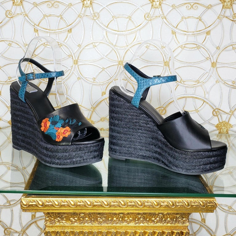 VERSACE    Platform SANDALS Versace's Black Wedge Heels    Color: black with blue and floral embroidery    Buckling ankle strap closure, round toe line   Rope wedge   Leather lining   Rubber sole  wedge's high: 5 1/4