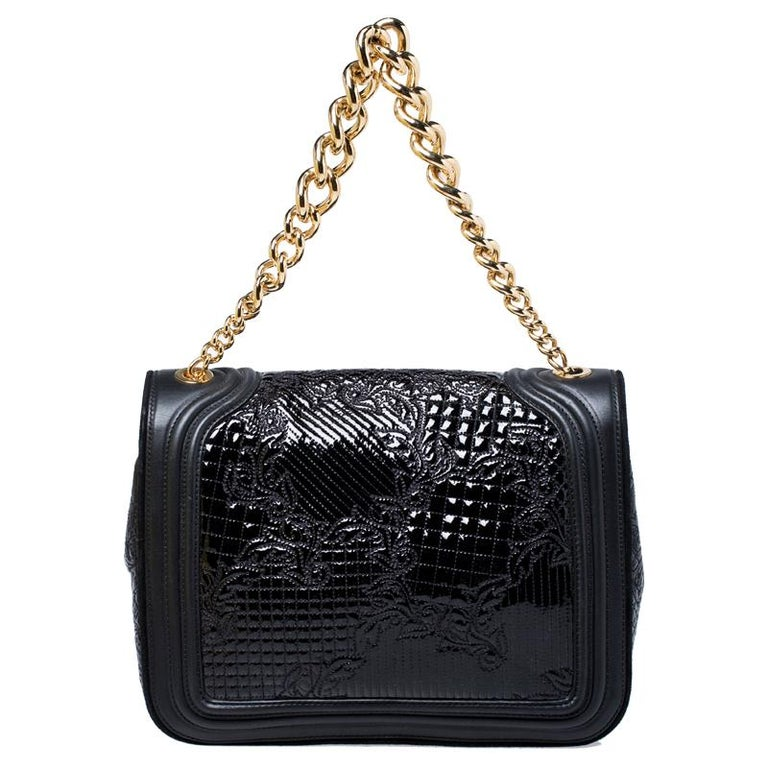 Embrace the prevailing trends in style with this chic bag by Versace. An example of luxe fashion, this beautifully crafted bag comes with a spacious nylon interior. Made in a leather and patent leather body, this bag can effortlessly be fashioned