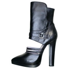 VERSACE BLACK LEATHER CUTOUT BOOTS with BLUE METALLIC SOLE
