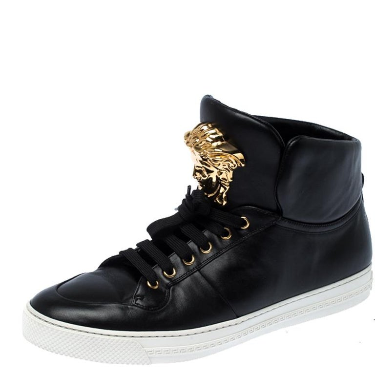 Brimming with fabulous details, these Versace sneakers are crafted from leather into a high-top silhouette and feature lace-up detailing at the front and gold-tone Medusa logo on the tongue. Comfortable soles and trendy appeal make these sneakers a