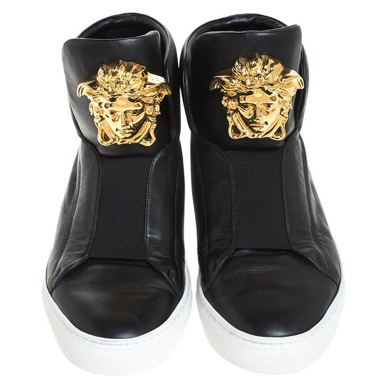 Sneakers are sought-after for reasons like comfort, ease and casual style. These Versace ones fit right in as they are stylish and snug. They come crafted from black leather into a design of elastic panels and the Medusa logo on the