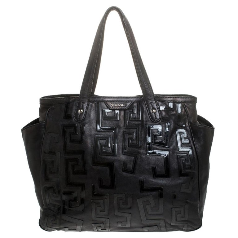 This shopper bag is carefully created from fine leather into an exquisite design. The inside of this chic bag is beautifully stitched with satin and sized spaciously. This Versace tote will elevate your style quotient and take it a notch