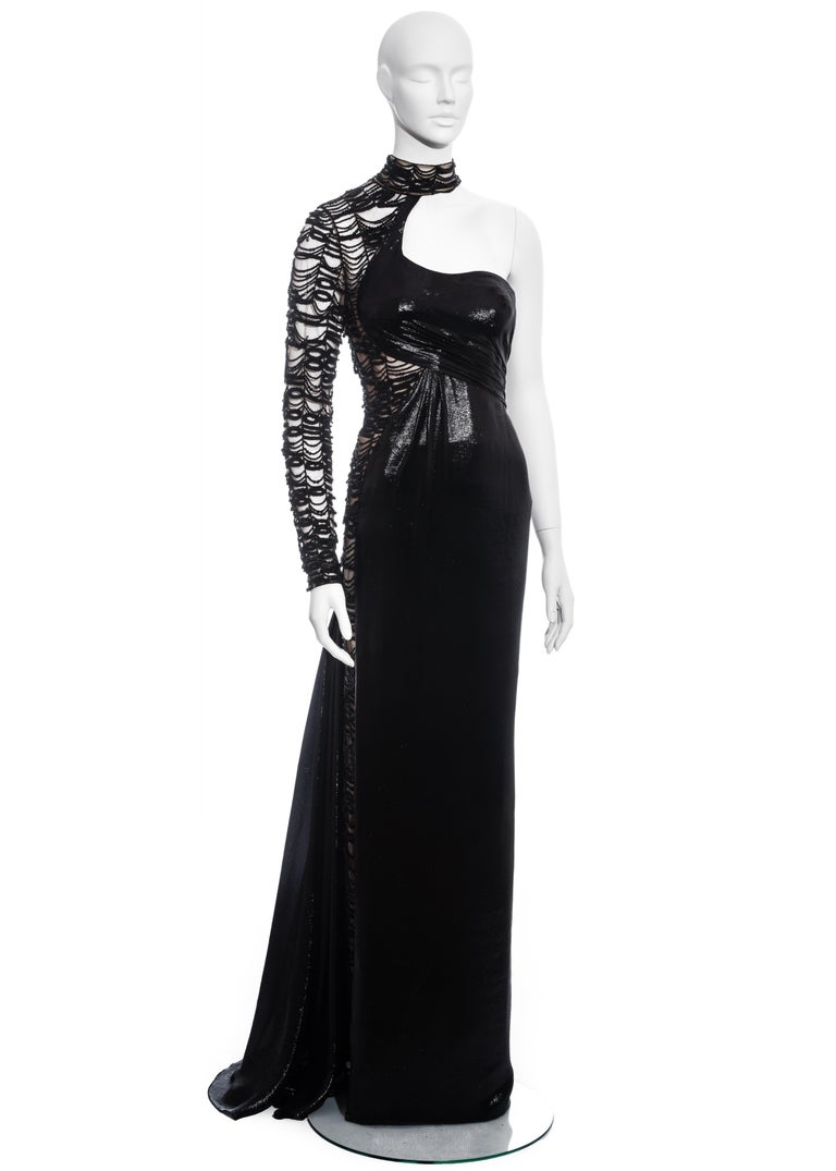 ▪ Black trained evening dress ▪ Mesh sleeve and side panel with beading and embroidery ▪ Choker neck fastening  ▪ Built-in mesh corset and bodysuit  ▪ IT 40 - FR 36 - UK 8 - US 4 ▪ Fall-Winter 2013