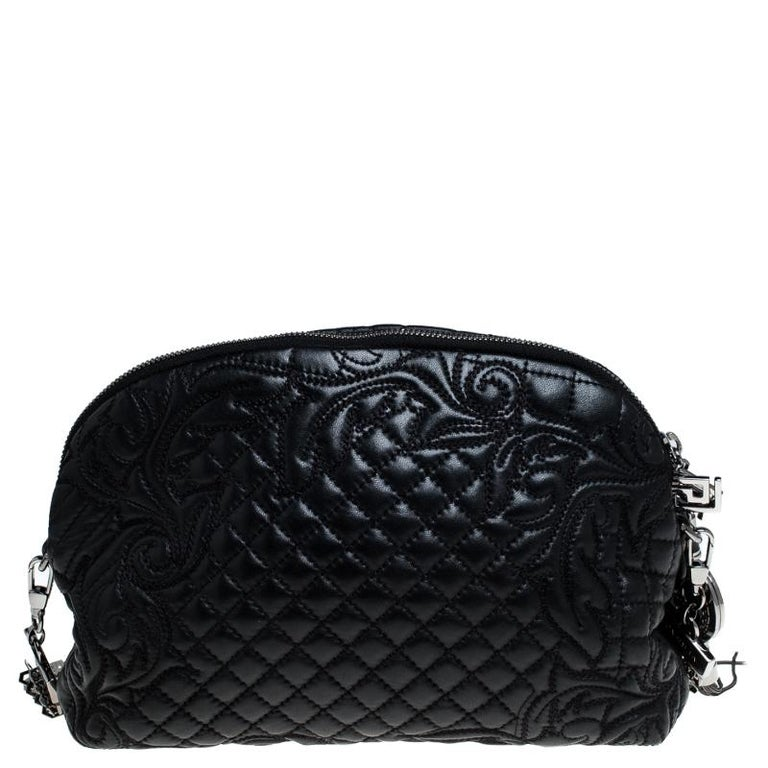 How gorgeous is this shoulder bag from Versace! Crafted from black leather and black-tone hardware, it carries an outstanding design. It has a satin interior secured by zippers and it is held by a metal-detailed shoulder strap. The quilt detailing