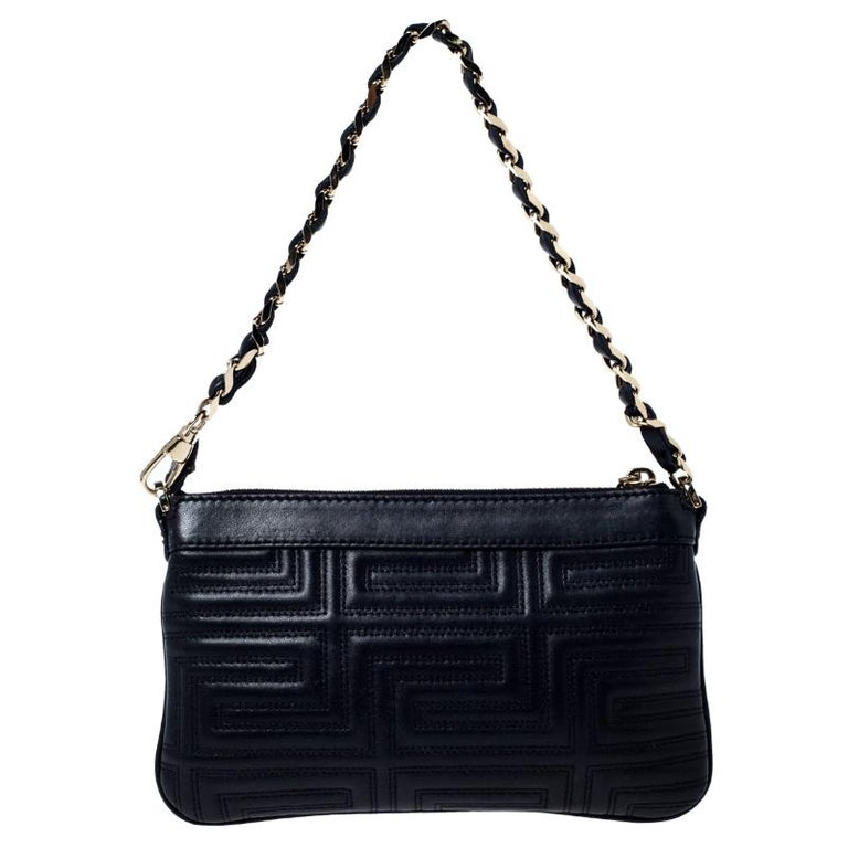 Simple and exquisite, this Versace clutch is a reflection of the label's fine craftsmanship and understated charm. It features a beautiful leather exterior covered in quilts and the zipper leads to a satin-lined interior that can hold your little