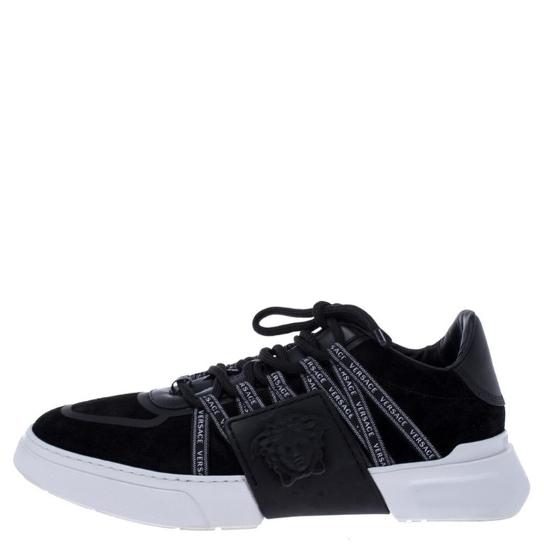 Sneakers are sought-after for reasons like comfort, ease and casual style. These Versace ones fit right in as they are stylish and snug. They come crafted from suede as well as rubber into a design of lace-up vamps and the Medusa logo on the