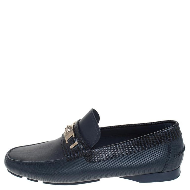 Precise stitching, use of quality leather and a calculated set of shape led to the final result of this pair of loafers. They are by Versace, and this is evidently displayed with the Medusa Icon silver detail on the uppers. The loafers are wrapped