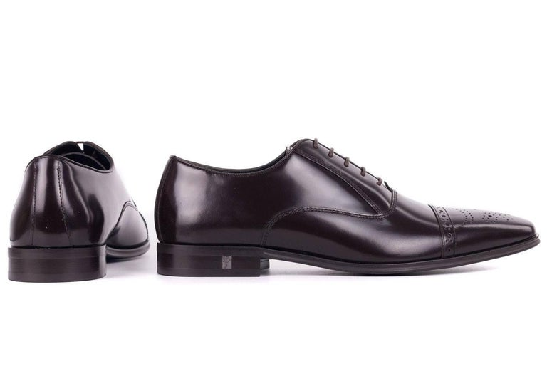 0d8bc60141 A refined man s first choice is the Versace Collection Wingtip Oxfords. You  can pair these