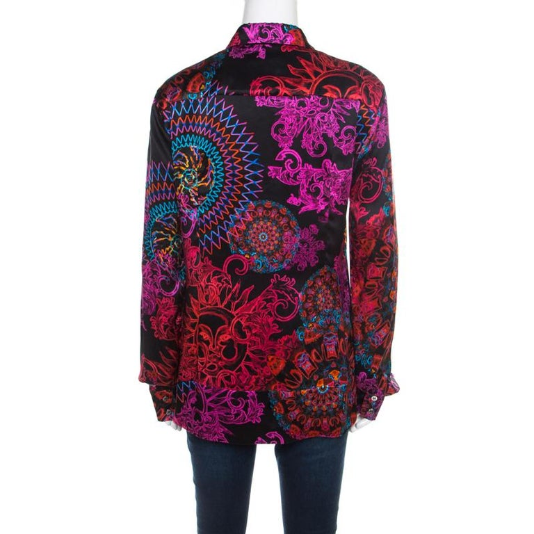This shirt from Versace Collection is comfortable to wear. The silk shirt comes with colourful prints all over. It features a simple collar, front button fastenings, and cuffed sleeves. A pair of black trousers and pumps will complete the look