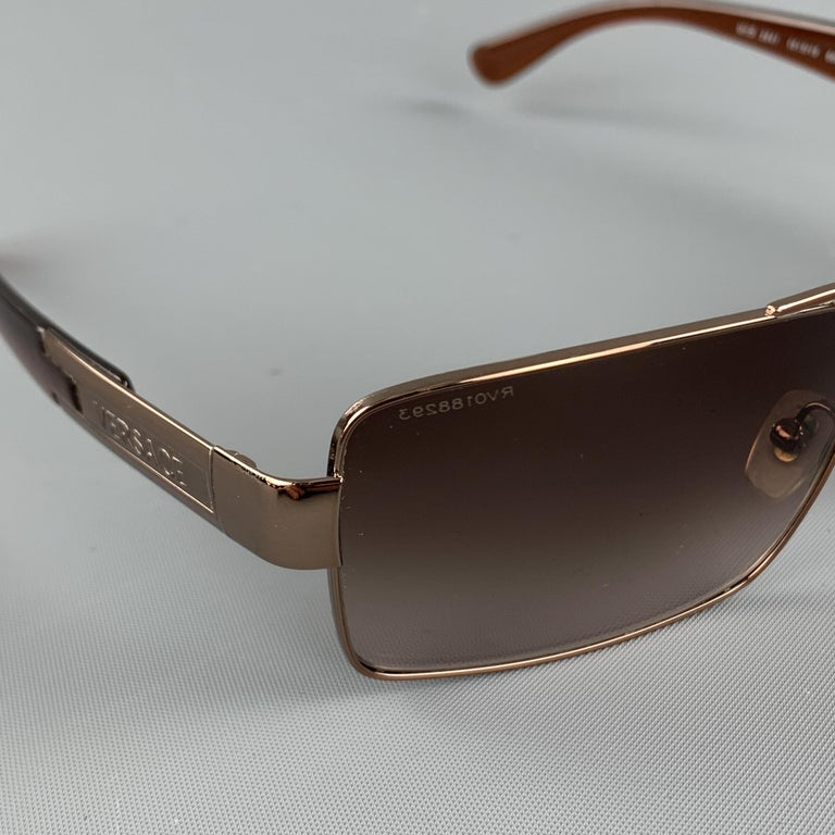 VERSACE sunglasses come in a copper tone metal with brown ombre square lenses and clear brown arms. Made in Italy..  Very Good Pre-Owned Condition. Marked: 2041  Measurements:  Length: 14 cm. Height: 4 cm