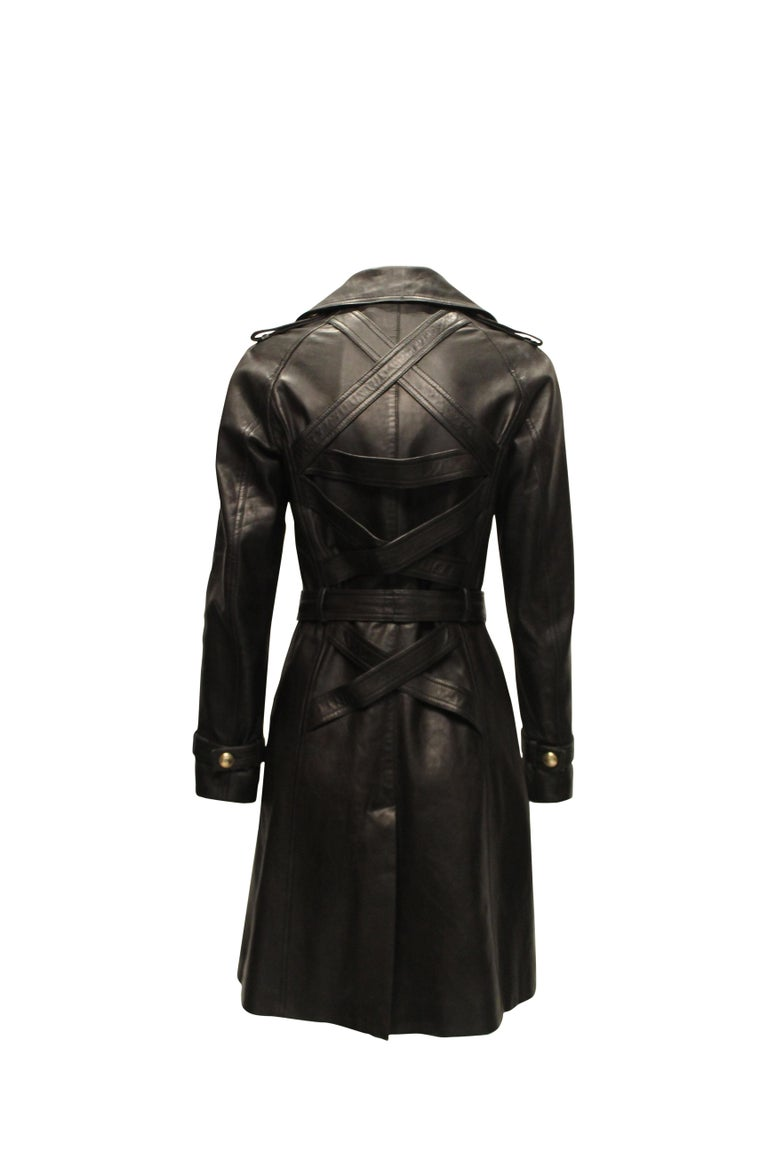 Versace double breasted leather coat. Featuring gold toned medusa head buttons and belt clasp.