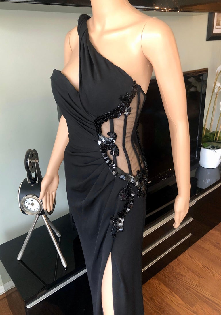 Versace Embellished Bustier Sheer One Shoulder Black Evening Dress Gown IT 40  Versace black evening gown featuring bustier embellished sheer mesh accent at side, one shoulder design and concealed zip closure at side.