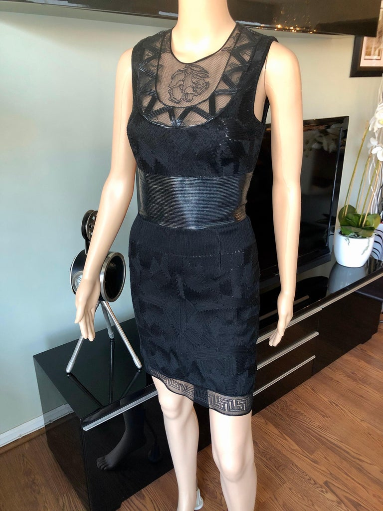 Versace Embroidered Sheer Mesh Panels Black Mini Dress IT 40  Versace black mini dress featuring tonal mesh accents and embroidered texture throughout, crew neck, concealed zip closure at back and hook-and-eye closure at nape.