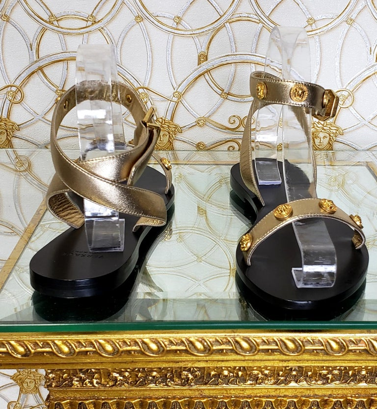 VERSACE GOLD LEATHER FLAT SANDALS with GOLD MEDUSA STUDS 36.5, 37.5, 38, 38.5 For Sale 1