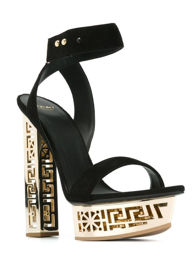 VERSACE SANDALS  Get a stylish lift with these sandals featuring a #GREEK motif metallic heel and platform.   They combine Italian craftsmanship and daring Versace design.   Suede  Metallic heel and platform  Made in Italy.  IT Size 41 - US 11  New,